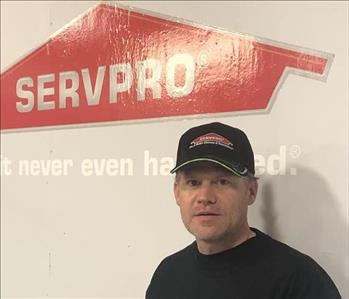 Head Shot of Gary Vaughn standing in front of the SERVPRO of Saline County and Hot Springs logo on the wall