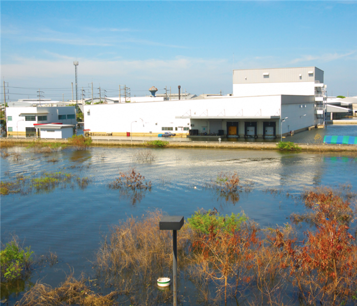 business building with flood waters rising quickly from all directions