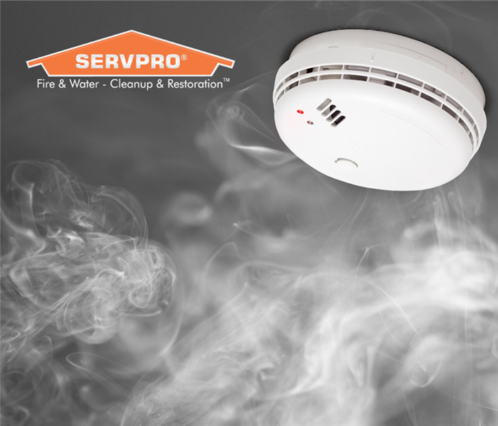 smoke detector with floating smoke and a SERVPRO logo